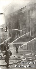 The large F. W. Woolworth in High Street Belfast, ablaze after a bombing incident in Northern Ireland's troubles in April 1974. The picture was used as a first day cover celebrating the achievements of the Northern Ireland Fire Service later the same year