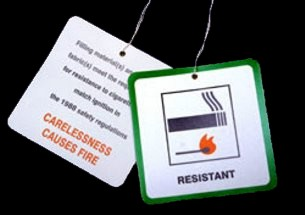 """Carelessness causes fire"" - a sign that appears on every piece of foam filled furniture sold in Britain, as a result of changes in the law stemming from the tragedy at Woolworth Manchester. These signs are believed to have saved lives, but the learning came at a very high price."