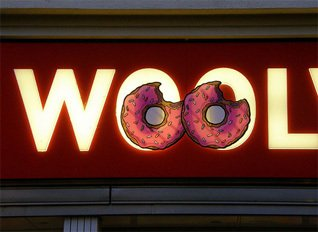 (Do) nuts about Woolworths - Matt Groening. The Simpsons creator kindly allowed Wooly and Worth to appear in a Simpson's style commercial, while Homer's donuts found their way on to the fascia of fity stores, promoting the Simpsons Movie