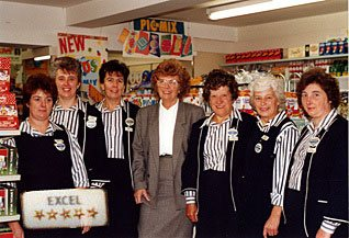 Store Manager Heather Grant introduces her 'Excellent' team from Woolworths Haslemere in 1987. Within a week of the launch of the initiative every member of her team had completed every stage.