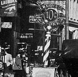 The decorative sign showing the entrance of the F.M. Kirby Five and Ten Cent Store in Columbus, Ohio, pictured in around 1895.