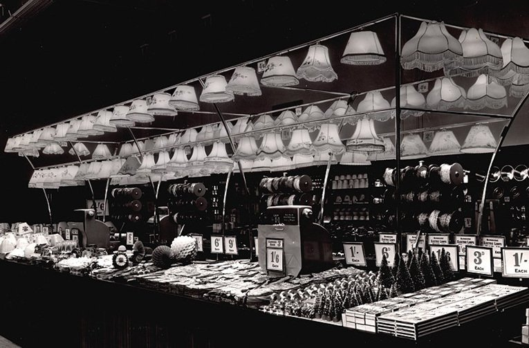 The Christmas Decorations at the Portsmouth store were displayed under the lighting canopy, which was used to sell shades and lamps during the rest of the year. The lights give the decorations an almost surreal shine.  Close inspection will reveal a number of post-war austerity measures which were still in force when the picture was taken in 1950