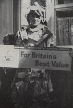 "This boy, a customer of the Ulverston, Cumbria store, clad from head to toe in Woolworth merchandise and carrying a banner promoting ""Britain's best value at Woolworths"" walked away with first prize in the Gosforth Fancy Dress Parade"