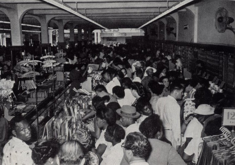 Opening day at Woolworths in Kingston Jamaica in 1954. The salesfloor was packed out with customers and the store was run off its feet!