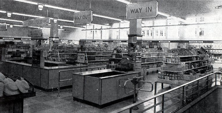 The food hall in the first Woolworths in Southern Rhodesia (Zimbabwe) in 1958. Like most features of the store interior it is identical to a store opened in Guildford, Surrey, UK in the same year.