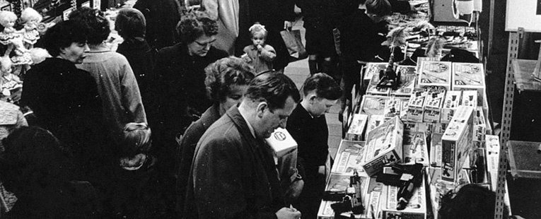 Toys in a bygone age, a father, mother and son, all smartly dressed, look at Airfix kits on sale in the F.W. Woolworth store in Briggate, Leeds, Yorkshire in 1959. Who knows what treat Santa delivered on Christmas morning!