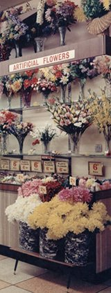 A bold display of artificial flowers, which added a splash of colour to the stores in the 1950s
