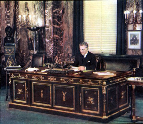 Byron Miller in the Napoleonic Setting of Frank Woolworth's office, shortly after taking over as Worldwide President in 1932.  He held the role until his 60th birthday in 1935, when he became a senior Non-Executive Director for a further twenty years.