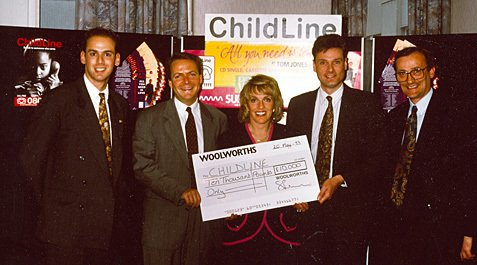 Esther Rantzen accepts a cheque towards Childline, which addressed a key taboo and went on to help many children who were suffering in silence