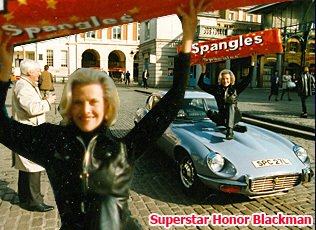 Honor Blackman helps Woolworths to relaunch Spangles - a popular boiled sweet from the Sixties. The former Bond girl certainly had the upper hand, winning over hearts and minds at the photo shoot in London's Covent Garden