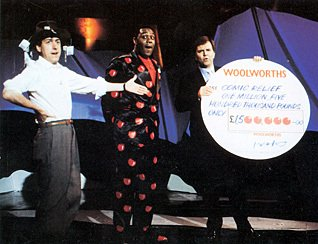 George Makulski, the Woolworths Marketing Director, hands over a cheque for £1.5m to superstars Lenny Henry and Griff Rhys-Jones (10th March 1988)