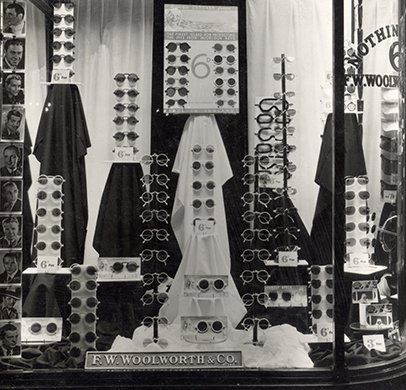 Sixpenny sunglasses in Woolworth's window in Maidenhead, Berkshire in 1937, promised they would protect shoppers' eyes from the sun's injurious rays. The low price had been achieved by using the latest wonder material, bakelite.