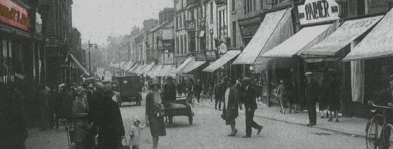 A bustling street scene outside Woolworth's in Barrow-in-Furness, Lancashire, which opened in 1926