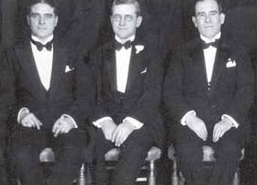 Bill Stephenson, Byron Miller and Hubert Parson sit side by side at the Annual Dinner of F. W. Woolworth Co. in New York. Each man served as supreme commander of a Woolworth company, but only one entertained royalty aboard his yacht