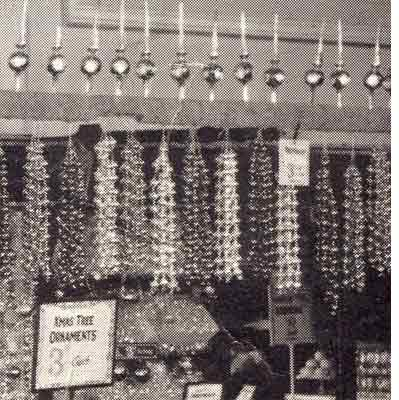 Popular Christmas Decorations from Woolworths in the 1920s - strings of beads to hang on the tree and 'finial baubles' for the top of the tree which were a glass decoration and candlestick in one.
