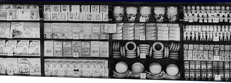 This wall display of Summer Toys at Woolworth's in 1955 features jigsaw puzzles, tinplate buckets, rubber rings and beach balls