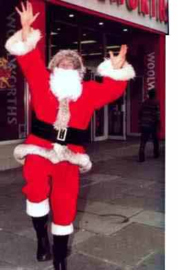 Behind the Santa suit was long-serving and much respected Woolworths Executive Roger Stafford, who after a spell in Store in Regional Management, followed in his father's footsteps in taking on the buying portfolio for cards and Christmas Decorations for many years, until he was asked to oversee the chain's campaign and readiness for Christmas business in 1996.  This picture of Roger appeared in Kingfisher's Annual Report in 1997